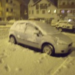 car covered in snow in arabba italy